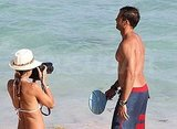 David Charvet shirtless with Brooke Burke in a bikini.