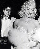 Channeling Marilyn Monroe, Madonna hangs with Michael Jackson in 1991.
