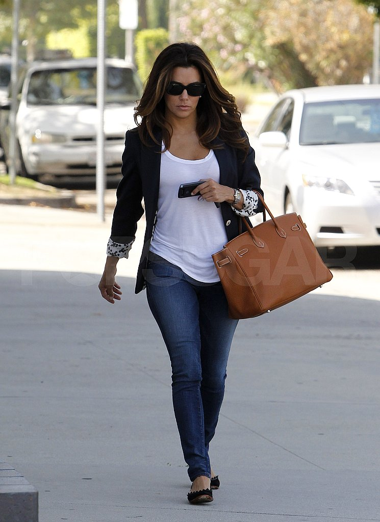 Eva Longoria heads to a Desperate Housewives photo shoot.