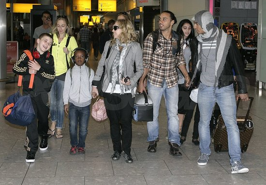 Madonna Arrives in London on Her 53rd Birthday With Her Four Kids and 24-Year-Old Boyfriend Brahim