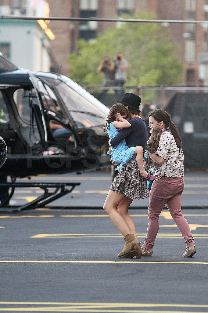 Katie Holmes and Suri Cruise at a heliport.