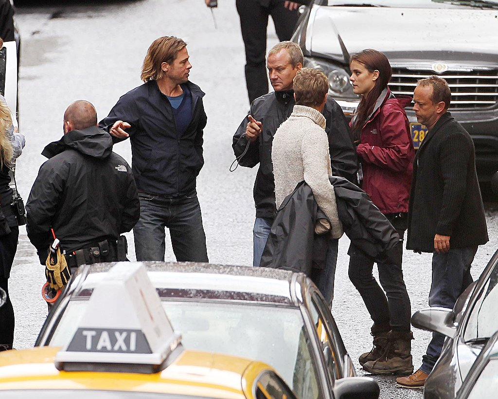 Brad Pitt chats with World War Z castmates.