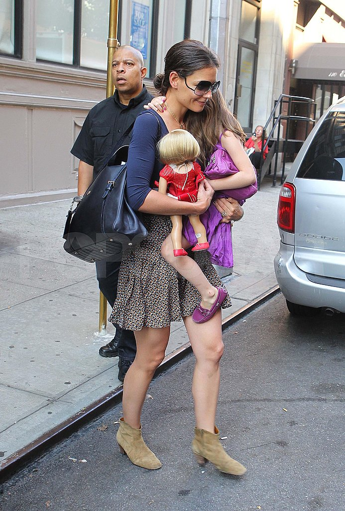 Katie Holmes and Suri Cruise leave their NYC apartment.
