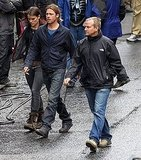 Brad Pitt walks around the World War Z set.