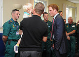 Prince Harry charms a kid.