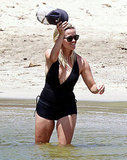 Reese Witherspoon in a black bathing suit.