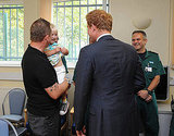 Prince Harry meets with emergency workers and their families in Salford, England.