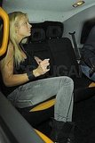 Chelsy Davy hops in a taxi.