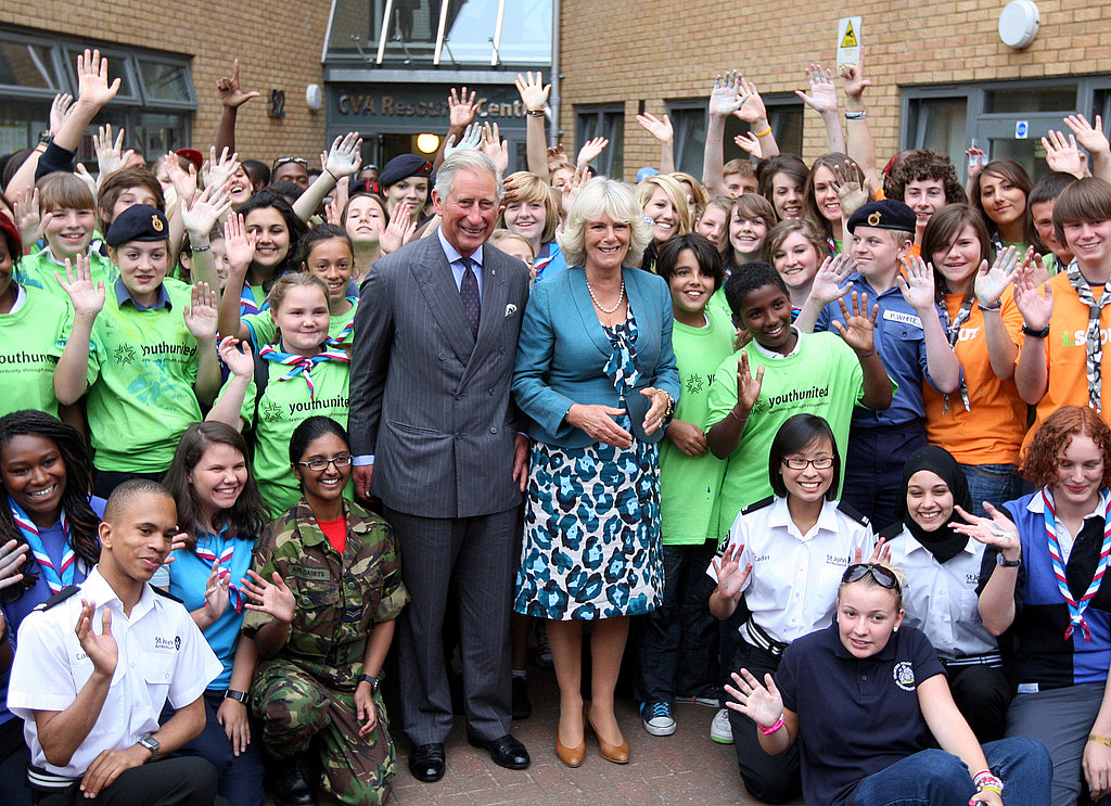 Prince Charles and his wife, Camilla, pose with people impacted by England's riots.