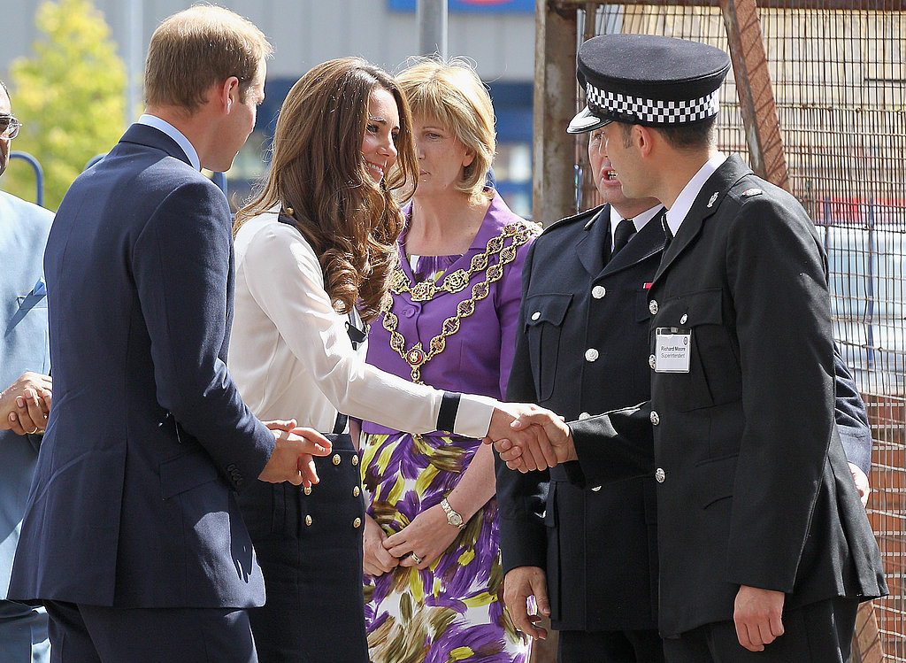 Kate Middleton meets members of the police force.
