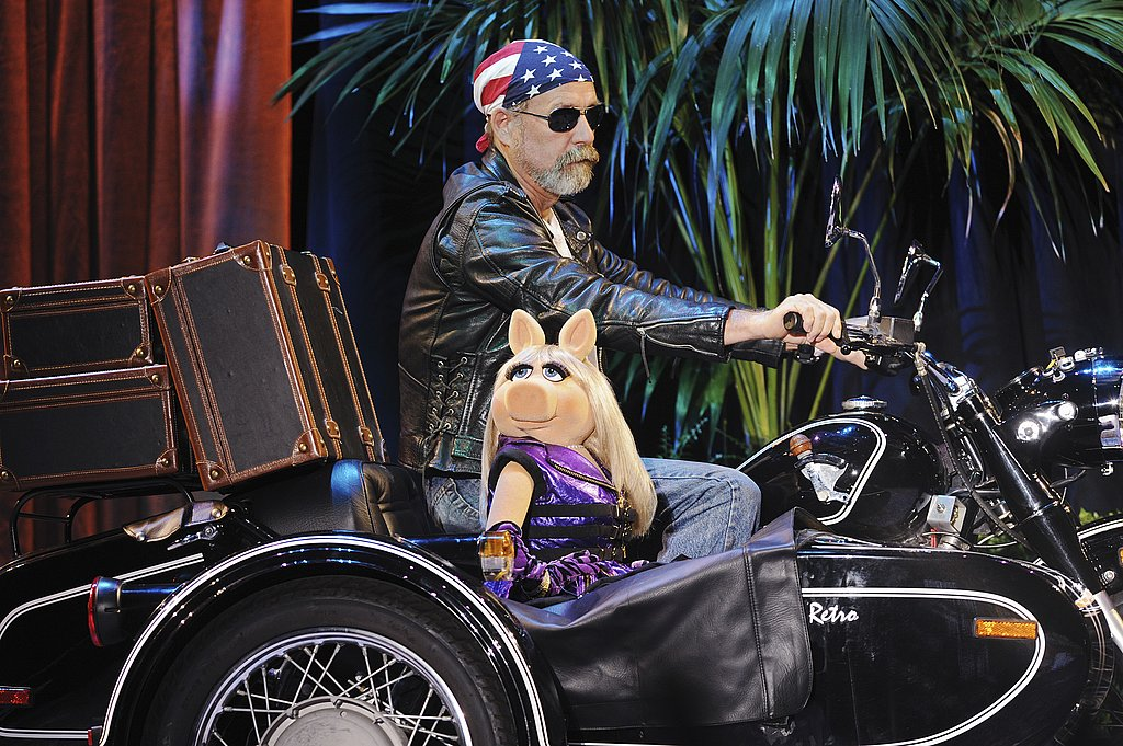 Miss Piggy was chauffeurred in a sidecar by a biker.