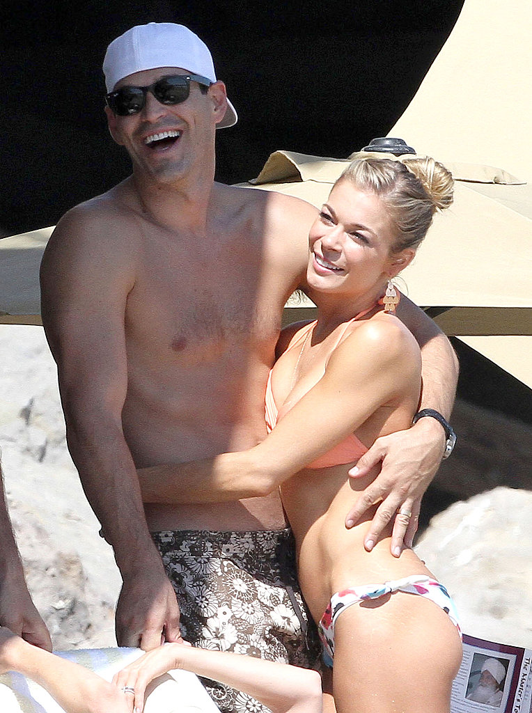 The happy couple were all smiles at the beach.
