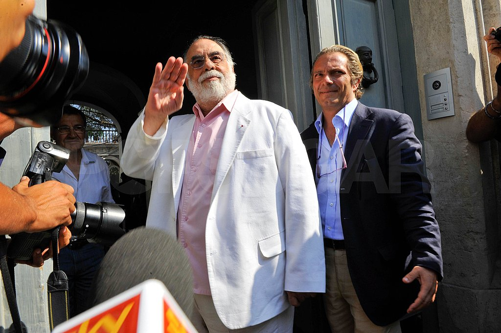 Francis Ford Coppola waved to Italian photographers.