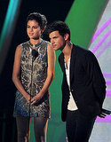 Taylor Lautner and Selena Gomez on stage at the 2011 MTV VMAs.