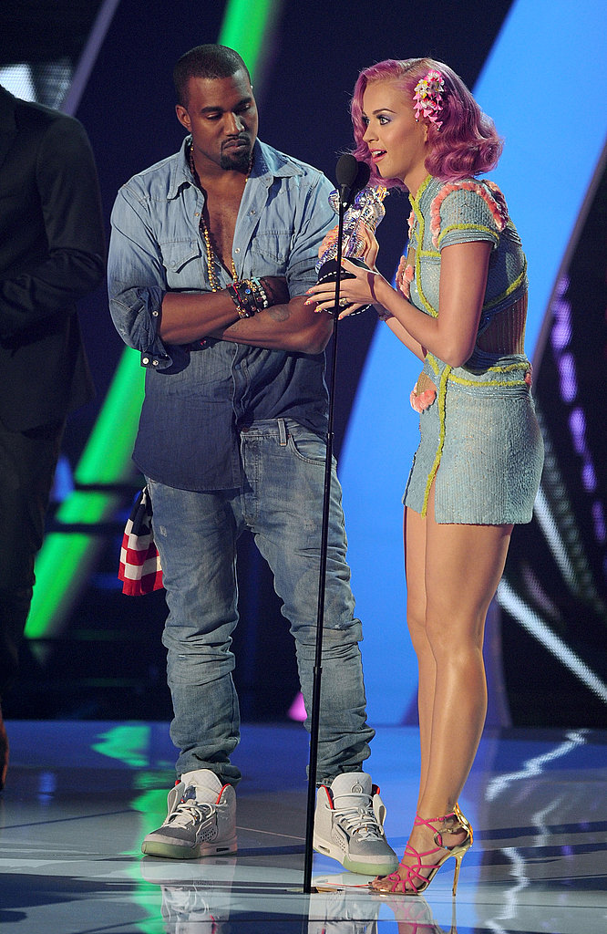 Katy Perry and Kanye West on stage at the 2011 MTV VMAs.