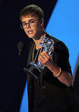 Justin Bieber accepts an award at the 2011 MTV VMAs.