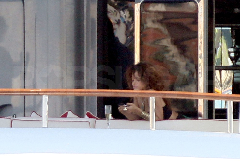 Rihanna checked her phone.