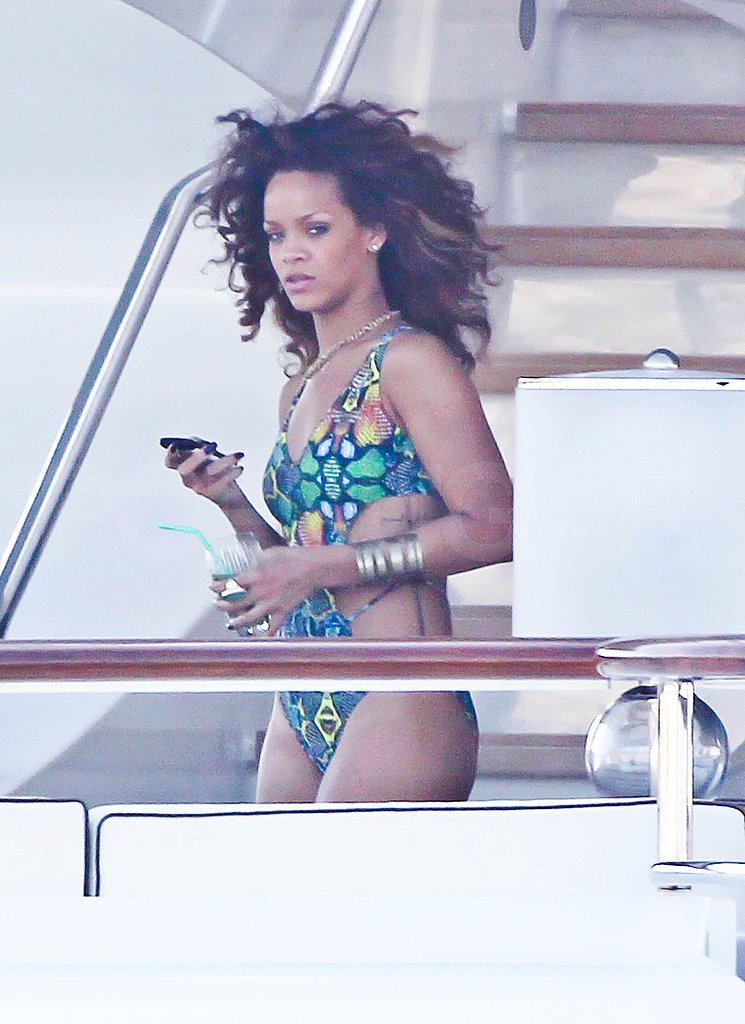 Rihanna changed into a wild and colorful one-piece.
