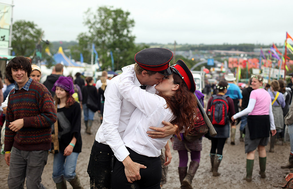 This guy was not afraid to give his lady friend's backside a squeeze at Glastonbury.