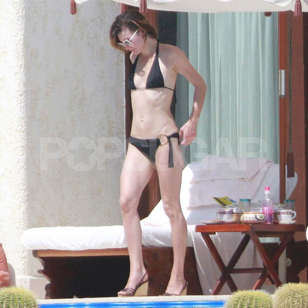 Milla Jovovich in a black bikini in Mexico.