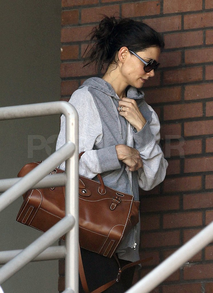 Katie Holmes carried a leather bag leaving the gym.