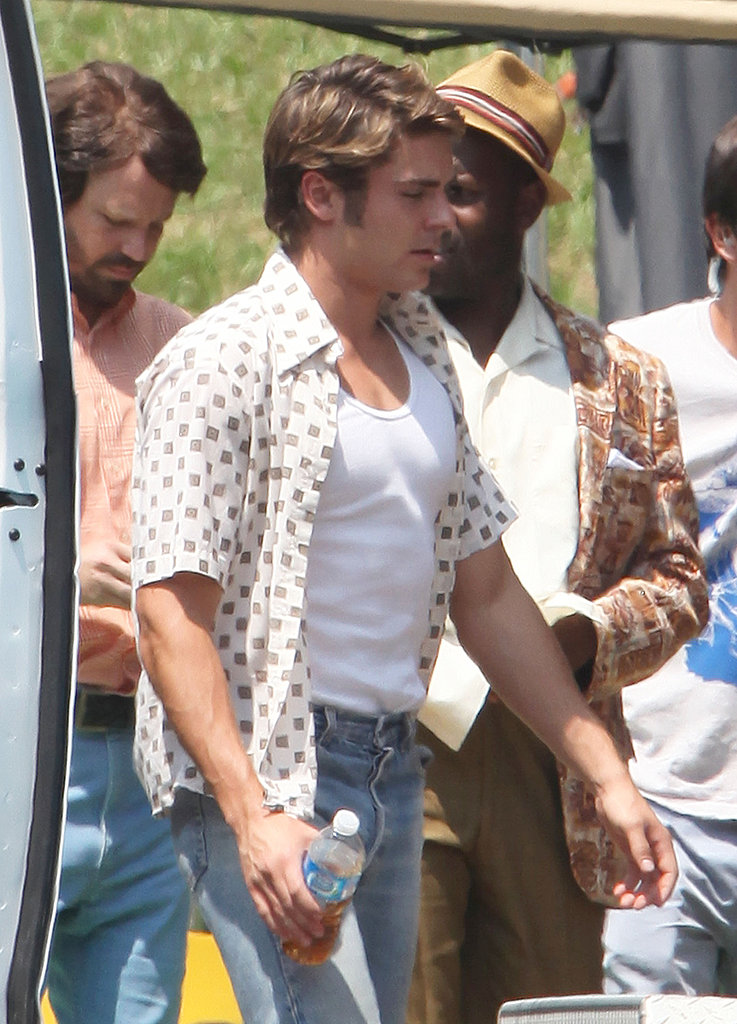 Zac Efron carried a drink in hand arriving on The Paperboy set.