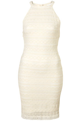 We love the play between the sexier silhouette and the prim lace detailing. Topshop Cream Lace Stripe Cutaway Bodycon Dress ($80)