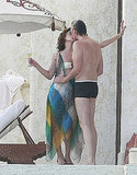 Milla Jovovich kissed Paul W.S. Anderson in Cabo.