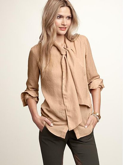 We love the neutral hue and casual neck tie. Gap Tie Neck Blouse ($50)