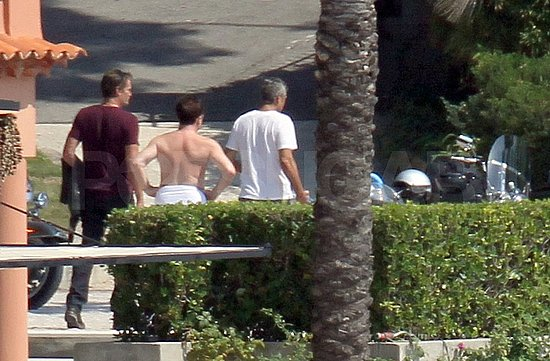 George Clooney and Rande Gerber inspected their motorcycles.