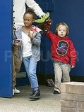 Zahara Jolie-Pitt with Knox Jolie-Pitt leave a London theater.