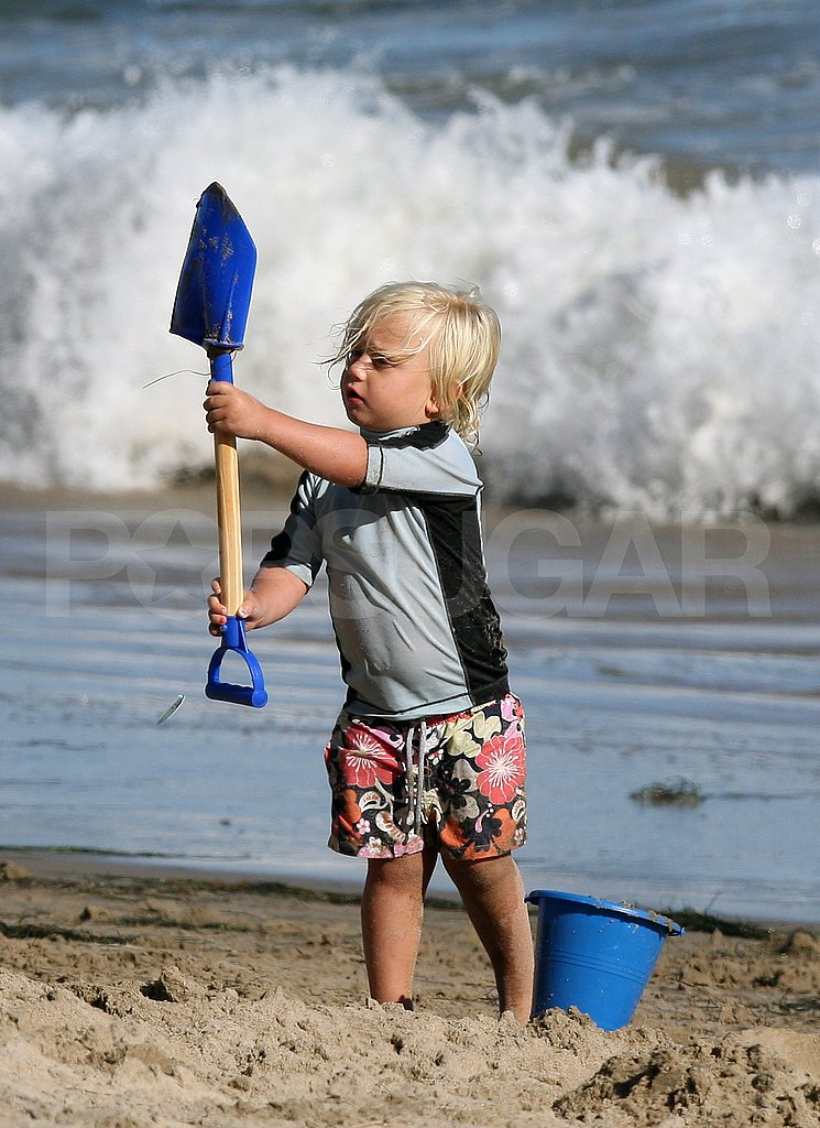 Zuma Rossdale plays on the beach.