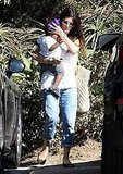 Sandra Bullock carries son Louis Bullock.