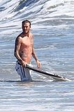 David Beckham body boarding in Malibu.