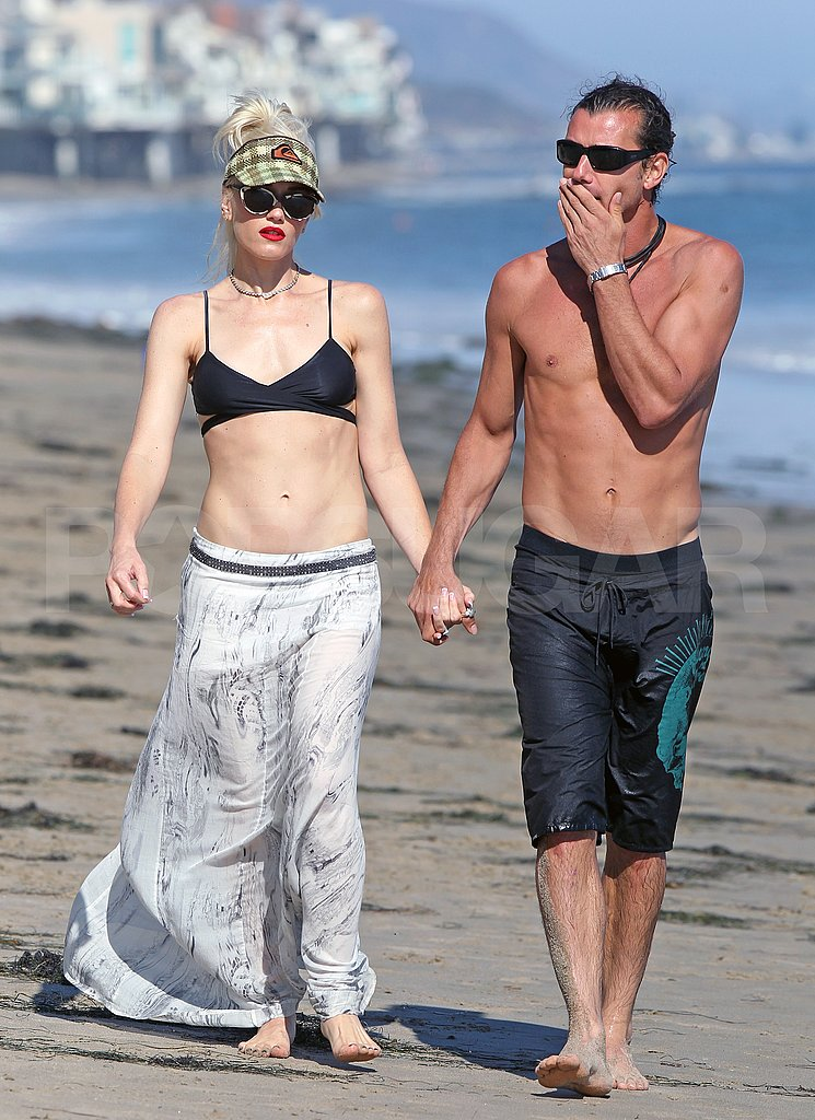 Bikini-clad Gwen Stefani holds hands with shirtless Gavin Rossdale.