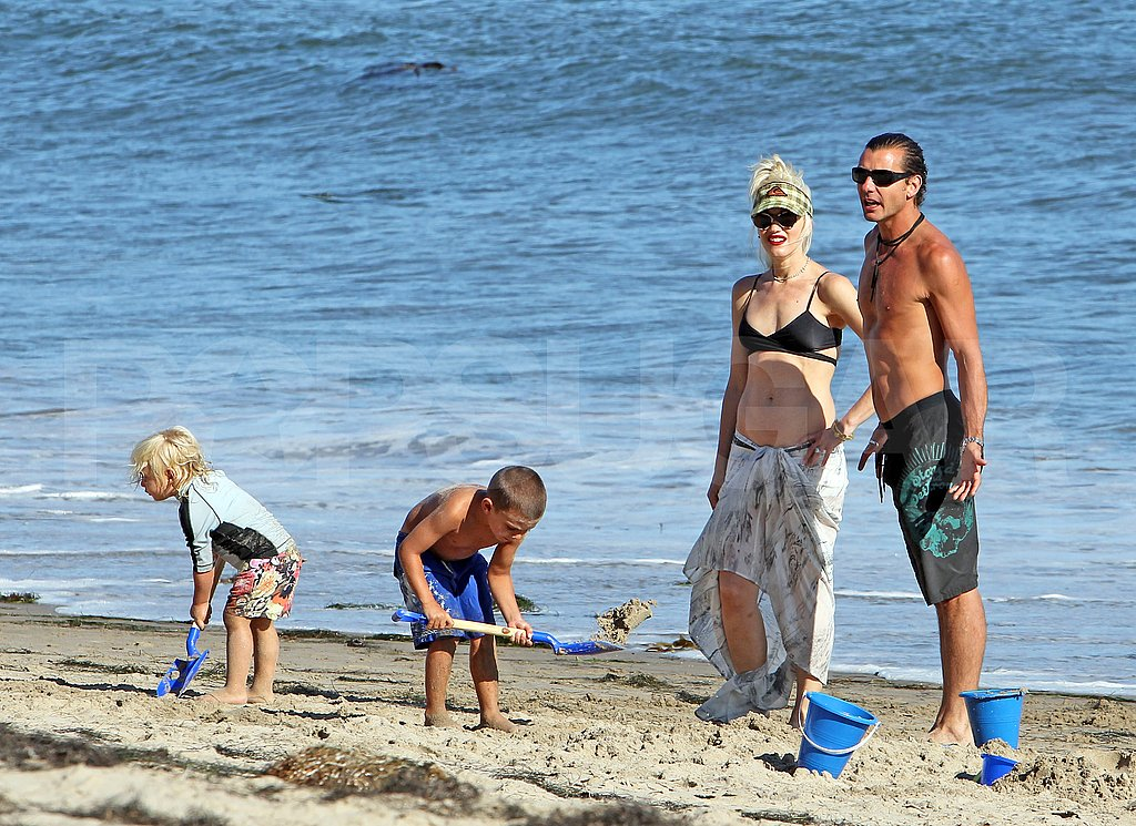 Zuma and Kingston Rossdale play on the beach with bikini-clad Gwen Stefani.