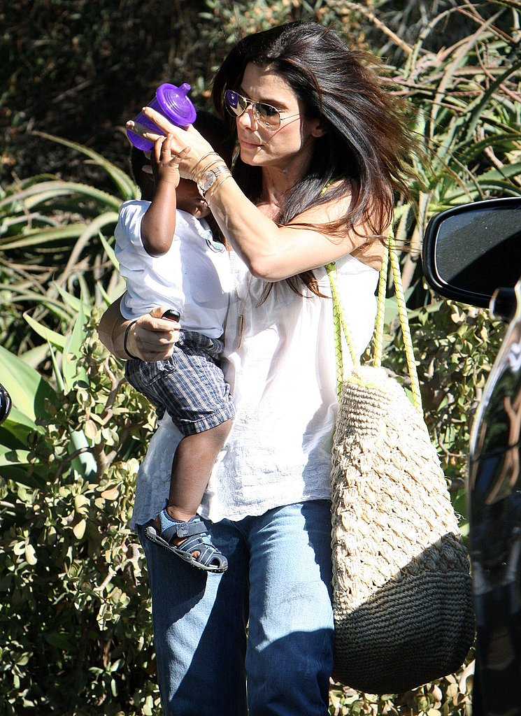 Sandra Bullock and Louis Bullock run errands.