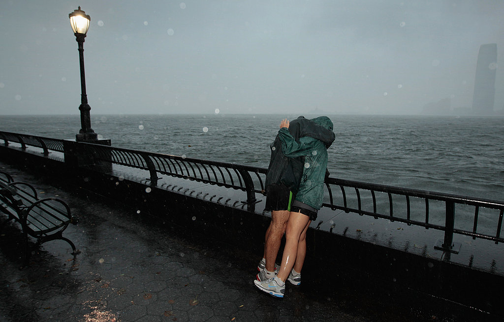 A couple embrace in the rain during a morning walk in NYC.