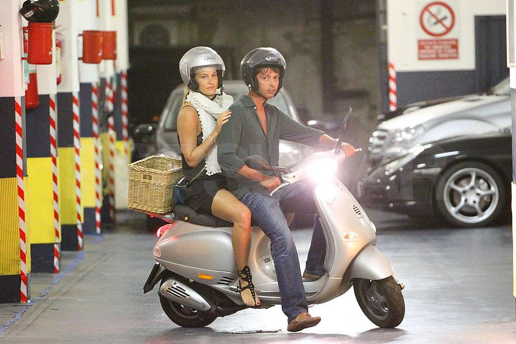 Bar Refaeli hitched a ride on a friend's bike.