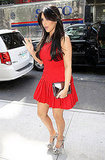 Kim Kardashian in a short red dress.