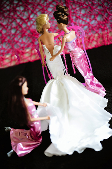 Barbie's bridesmaids help with her dress. Photo by BdG Photography via Rock n Roll Bride