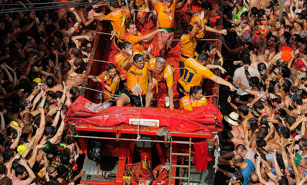 Revelers pelt each other with tomatoes during the annual Tomatina festival.