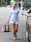 Reese Witherspoon with a tote bag.