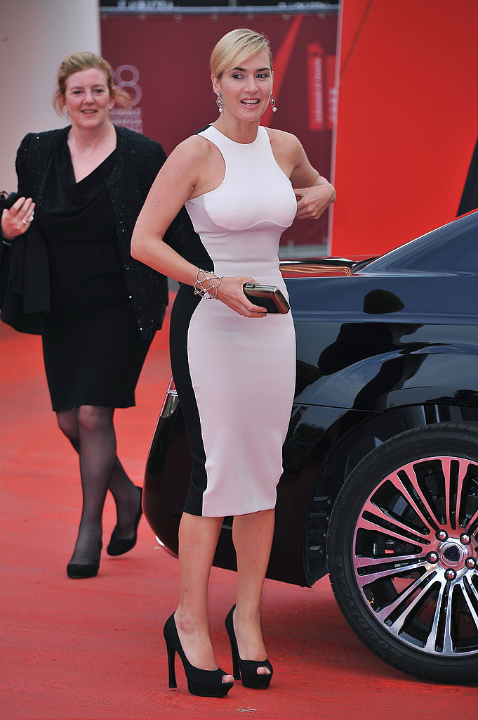 Kate Winslet in white on the red carpet.