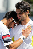 Janko Tipsarevic of Serbia and Philipp Petzschner hug it out.