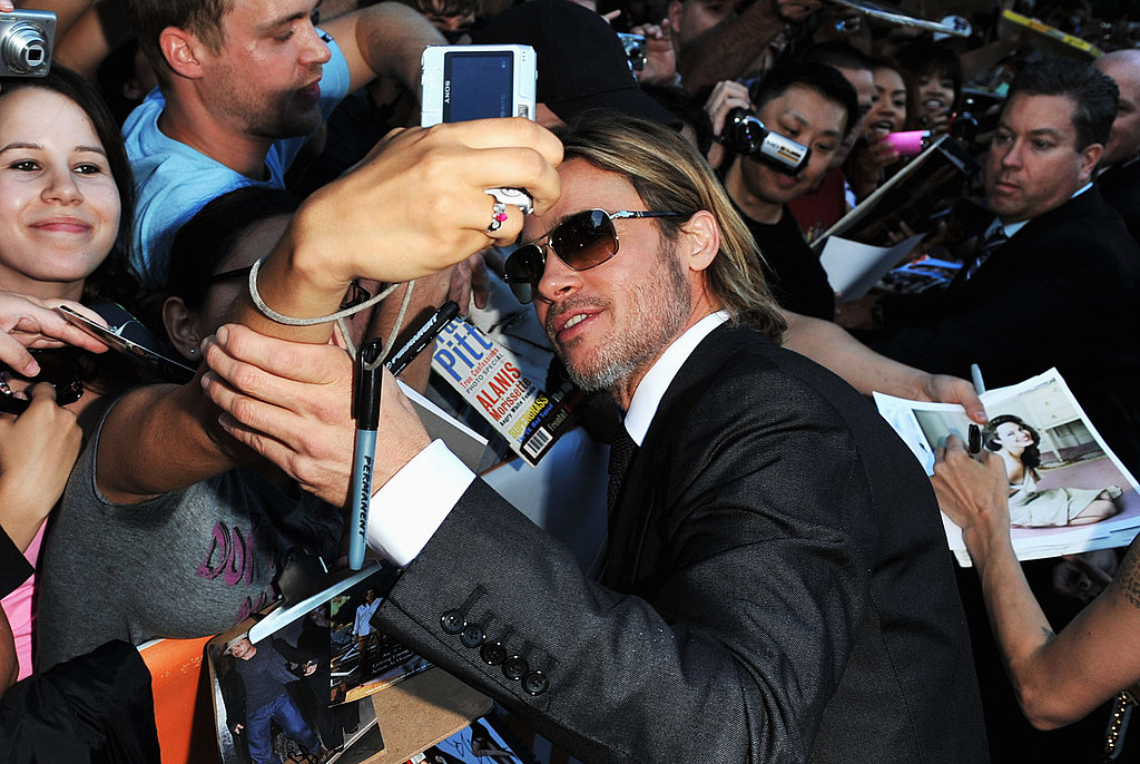 Brad Pitt snapped photos with fans.