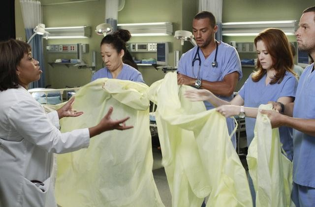 Chandra Wilson as Dr. Miranda Bailey, Sarah Drew as Dr. April Kepner, Justin Chambers as Dr. Alex Karev, Jesse Williams as Dr. Jackson Avery, and Sandra Oh as Dr. Cristina Yang on Grey's Anatomy.  Photo copyright 2011 ABC, Inc.
