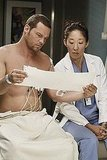 Justin Chambers as Dr. Alex Karev and Sandra Oh as Dr. Cristina Yang on Grey's Anatomy.  Photo copyright 2011 ABC, Inc.