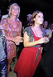 Princess Beatrice watches a performance with Holly Branson.