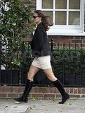 Pippa Middleton in high black boots.